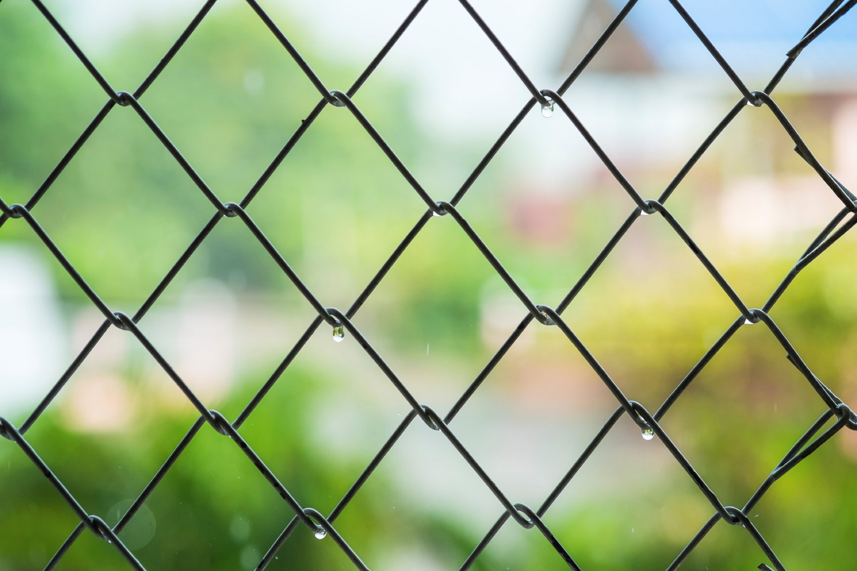 Steel cage with blur background in raining day