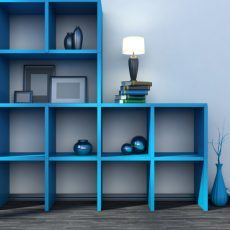 blue shelf with vases, books and lamp