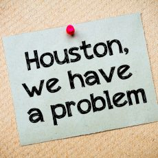 Houston, We Have a Problem Message. Recycled paper note pinned on cork board. Concept Image